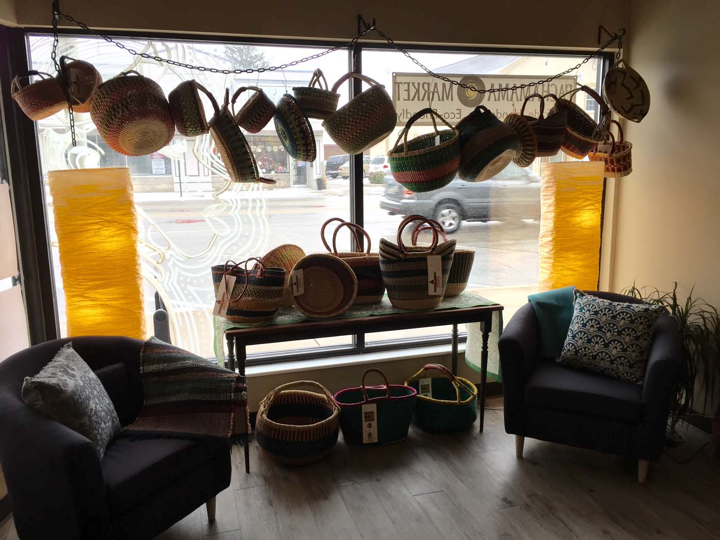 A horizontal window display that showcases the baskets
