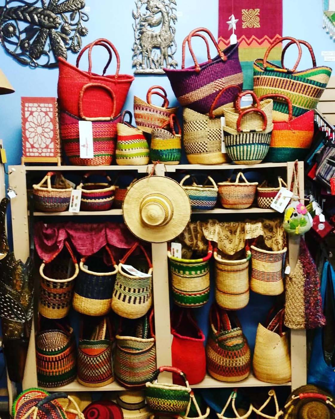 Simple store shelves are brightened by Bolga baskets