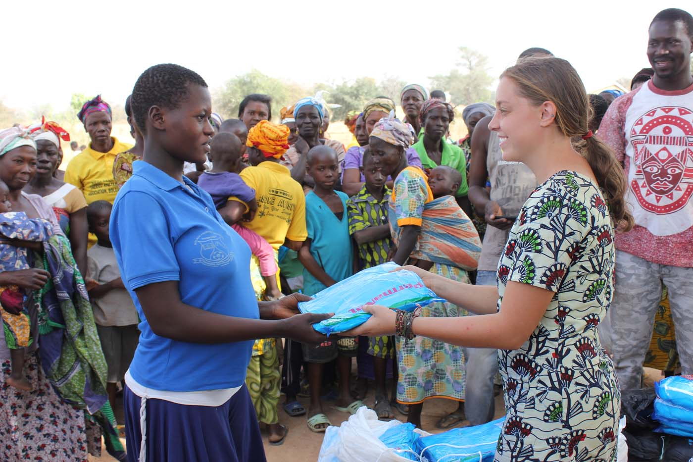 Our Peace Corps volunteer handing out a mosquito net