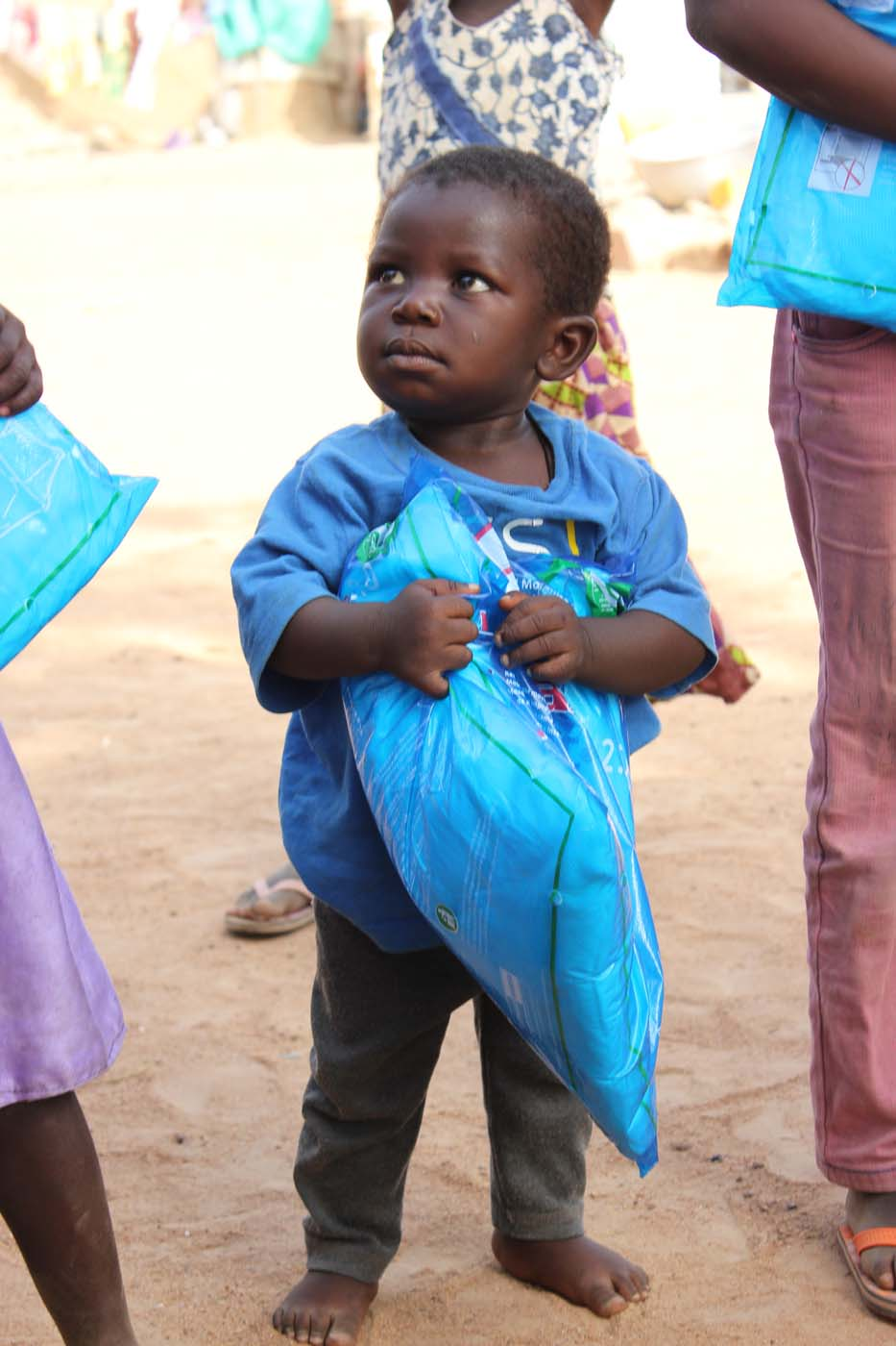 A child with their mosquito net