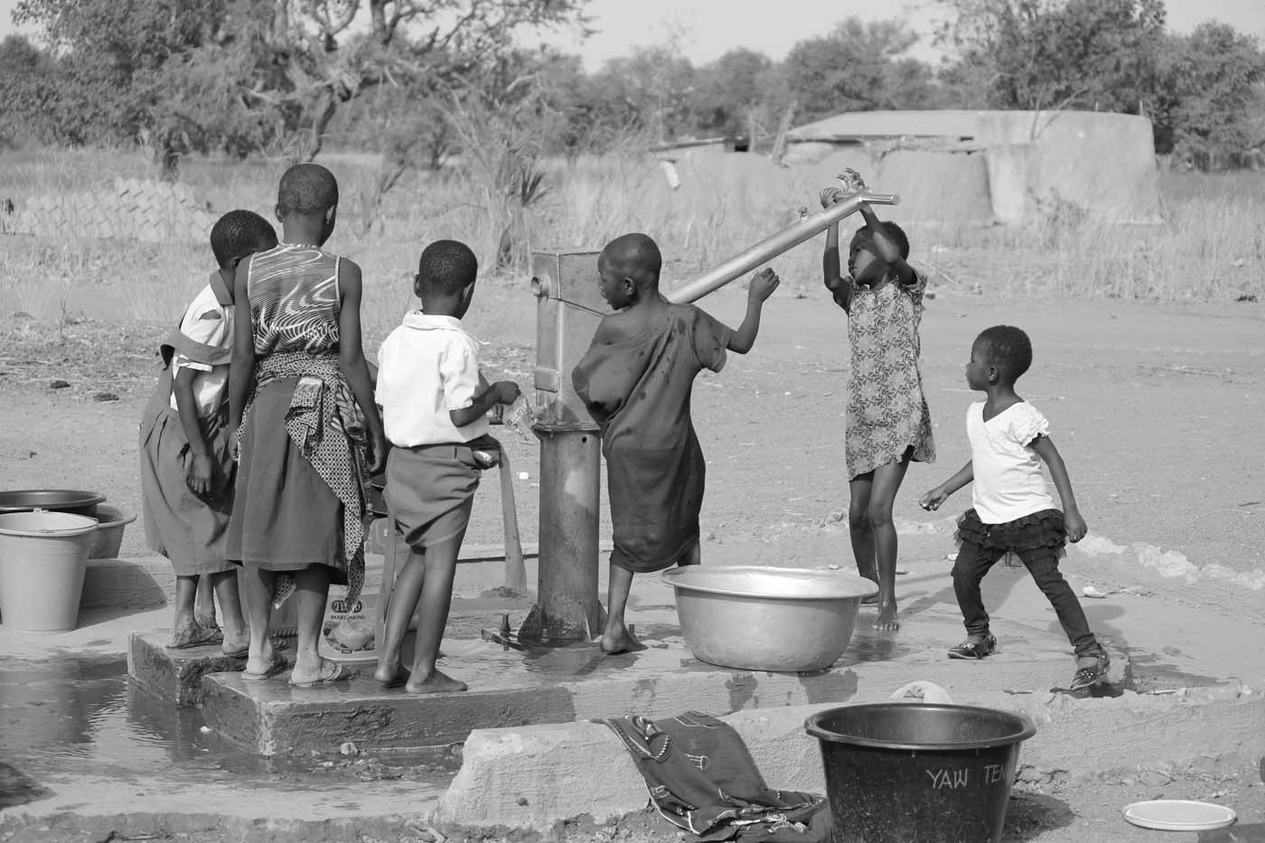 Children fetch water from a young age