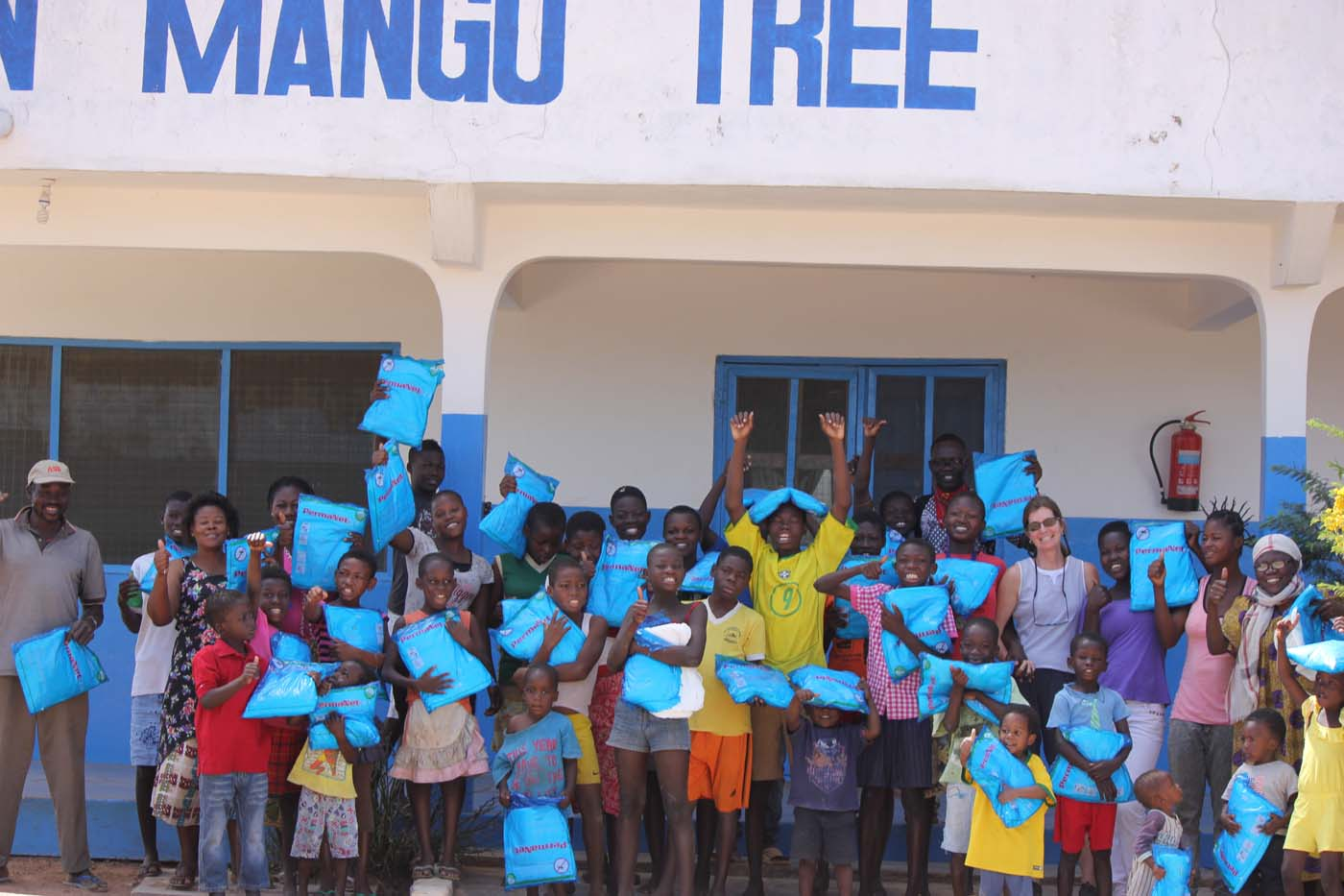 Distributing mosquito nets at an orphanage