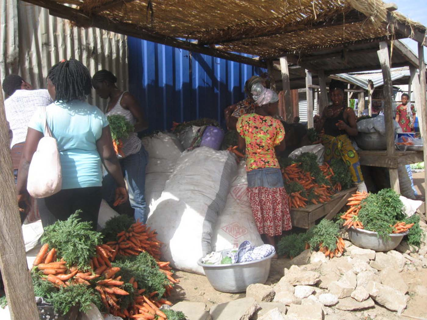Women selling carrots and other wares