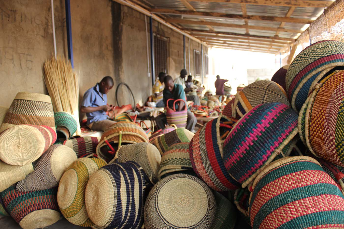 Leatherworkers adding leather handles to baskets