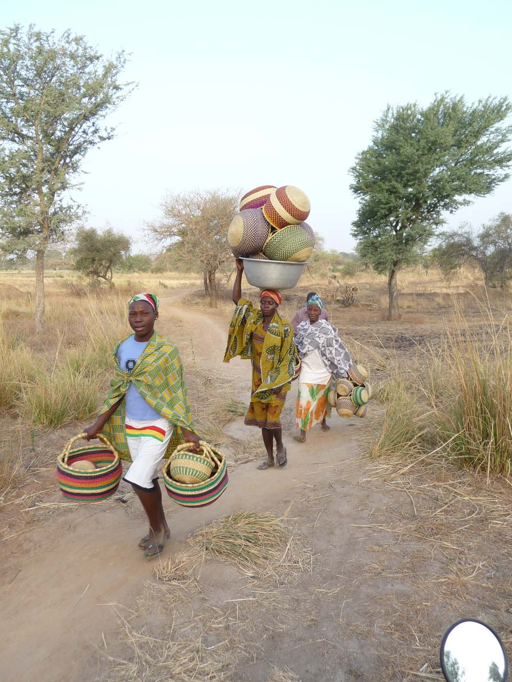 Women often carry baskets for other women in the village
